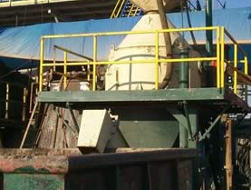 Mud separation from drilling cuttings waste